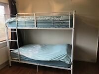 Bunk beds- sturdy white metal frame