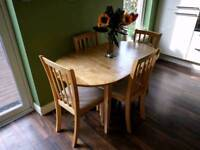 Beautiful extendable 2 to 4 person wooden dining table and 4 wooden/suede chairs