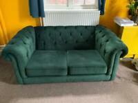Bottle green velvet sofa