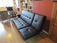 John Lewis faux leather black sofa bed. Converts from a large 6ft 6 inch sofa to a 4ft double bed.