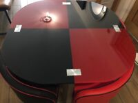 Compact red & black glass Table and Chairs
