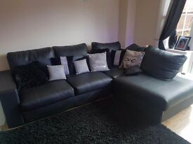 Leather black right hand corner sofa