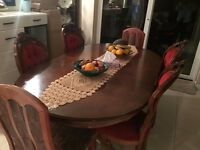 Dinning Table with 6 chairs, table is scratched in top. Going Cheap. 07411779151