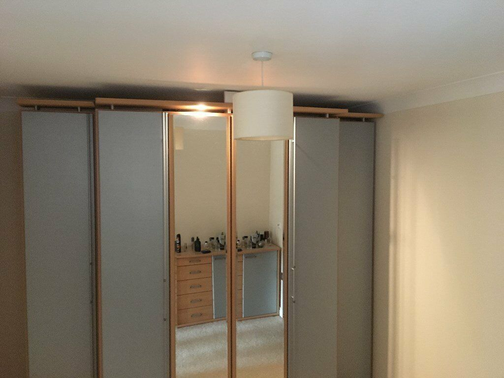 *BARGAIN* Nolte double mirrored wardrobe with shelved cupboards either side