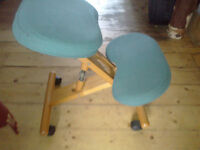 Ergonomic kneeling chair, blue fabric and wood, adjustable. Great for sore backs.