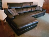 Black real leather corner sofa with manual recliner