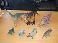 Set of seven dinosaur figures.