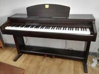 Yamaha CLP910 digital piano,Clavinova.In reasonable condition.Fully functional .Comes with stool.