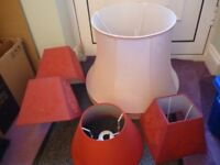 five lamp shades,one large pink and four medium in red,very good lamp shades, all for only £15......