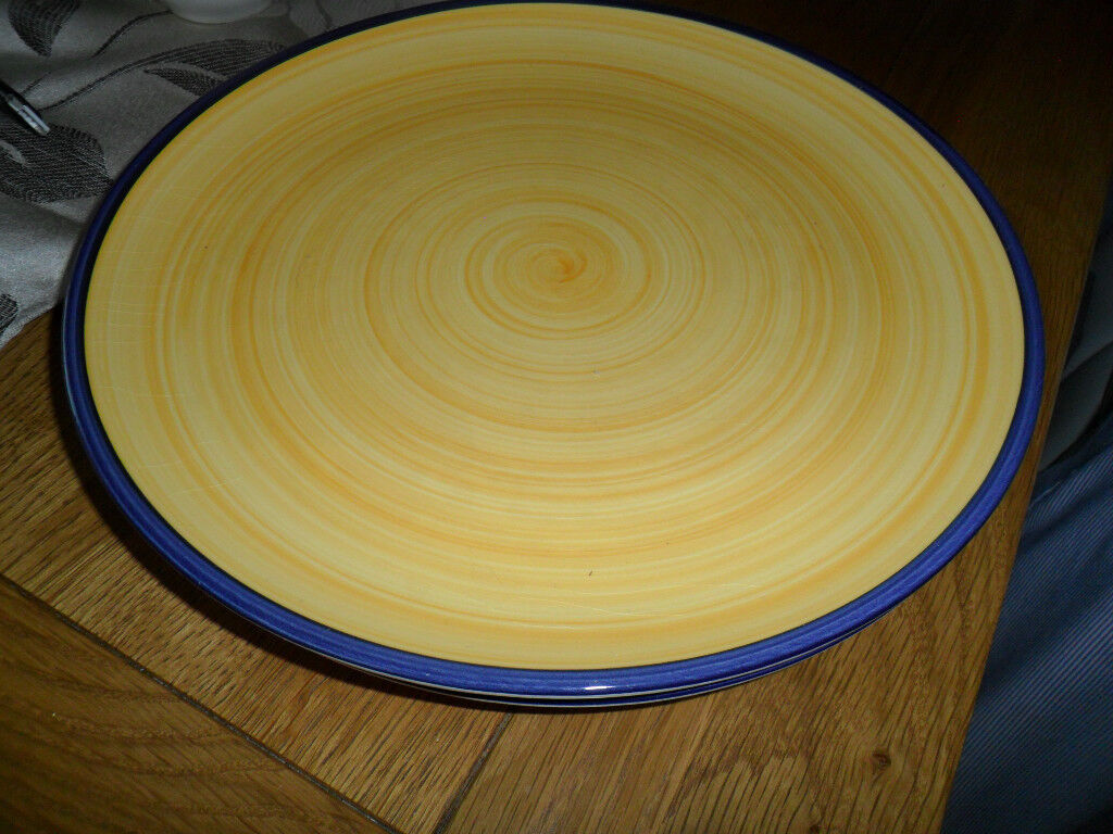 4 lovely yellow and blue trim dinner plates