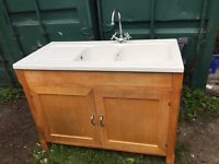 Wood sink unit and ceramic sink with tap