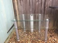 Glass Corner TV stand offered for free