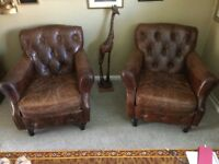 Two matching vintage button back leather chairs