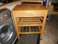 large kitchen wooden storage trolley on castors