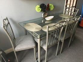 Large Glass dining table and 4 chairs on very good condition. Price ono
