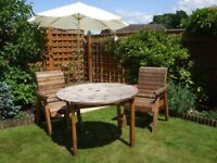 A Charles Taylor redwood 46 diameter Garden Table and 4 Chairs