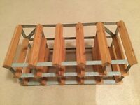 Wine rack.Wooden and metal. Holds 15 bottles horizontal or 12 bottles vertical.