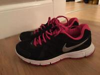 Ladies size 4 Nike trainers black with white sole , grey Nike logo