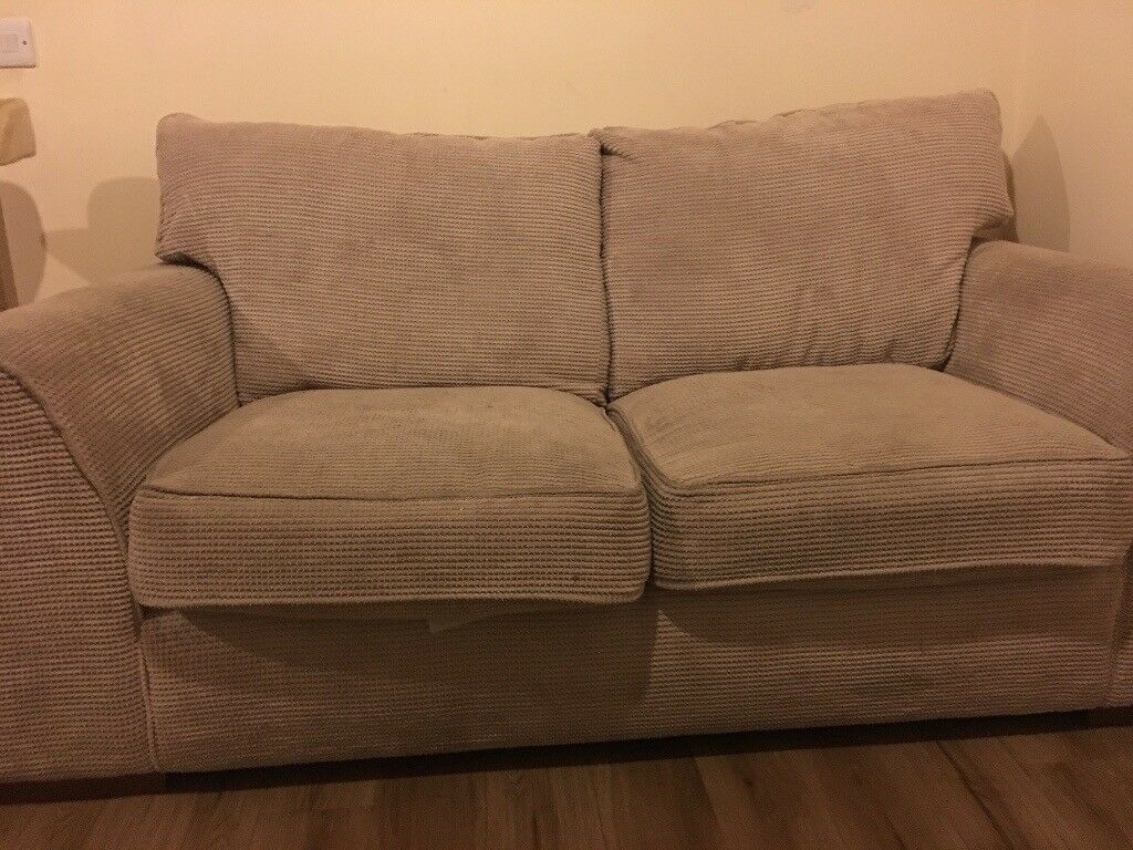 Two seater and one seater off cream sofa