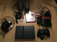 PlayStation 2 Slim with Controller, Buzz the Music Quiz with Contollers & Speakers