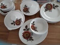 Royal tudor dinnerware with serving dishes and meat plate
