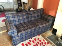 Ikea two seater sofa blue tartan selling with brand new white cover