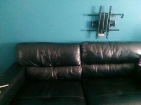 Sofa black leather good condition ,