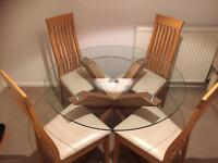 NEXT SOLID OAK AND GLASS DINING TABLE