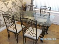 Stylish Baroque Glass Dining Table and Four Chairs.