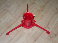 red wrought iron Christmas tree stand
