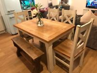 Lovely 4/6 seater solid wood dining table & chairs
