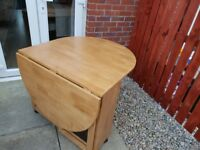 Drop leaf oak table and 4 chairs