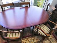 Wooden dining table with 5 chairs
