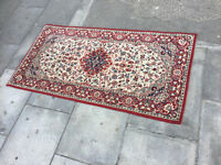 Rug in good condition. Size 160cm x 80cm . Red in colour .