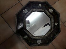 Octagonal mirror with decoration.