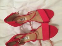 Brand new red sandals size 4