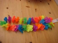 Brand new Flower Garland, great for fancy dress parties. Very colourful. Can be posted for £1