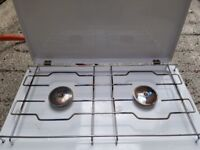 Two burner portable gas stove with lid.