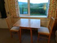 Oak finish drop leaf dining table and two matching chairs