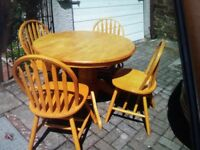 Pine coloured dining table and 4 sturdy chairs