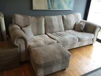 4 seater custom made sofa with two cushions and footstool which opens out for storage
