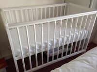Immaculate White Wooden baby cot with mattress. Pet and smoke free home.