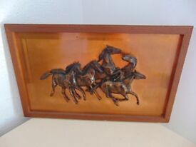 Copper picture of wild horses galloping.