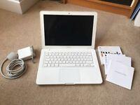 MacBook with original charger, setup and iWork