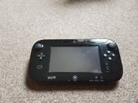 Wii u in brand new condition with 2 games.