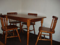 Kitchen dining table and 4 chairs in solid pine with low gloss/matt varnish. Excellent condition.