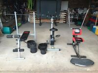 Exercise Equipment including: Excercise bike, weights, weights bench and Ab Scissor
