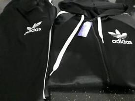 Adidas TRACKSUIT size large unisex