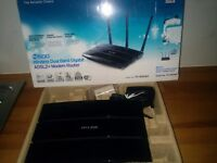 Modem router tp-link td-W8980 not needed as new one supplied by fibre brdband supplier