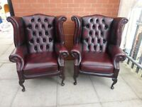 A Pair of Deep Oxblood Red Leather Chesterfield Armchairs